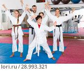 Купить «Happy kids karate group with coach», фото № 28993321, снято 6 августа 2018 г. (c) Яков Филимонов / Фотобанк Лори