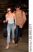 Купить «LeAnn Rimes with her husband Eddie Cibrian at Los Angeles International Airport (LAX) Featuring: LeAnn Rimes, Eddie Cibrian Where: Los Angeles, California...», фото № 28995077, снято 26 апреля 2017 г. (c) age Fotostock / Фотобанк Лори