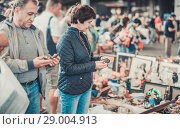 Купить «Man and his wife are visiting market of old things», фото № 29004913, снято 23 октября 2017 г. (c) Яков Филимонов / Фотобанк Лори