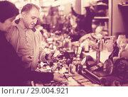 Купить «Smiling man and woman at traditional flea market», фото № 29004921, снято 23 октября 2017 г. (c) Яков Филимонов / Фотобанк Лори