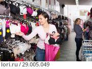 Купить «Woman selecting bra in lingerie store», фото № 29005049, снято 24 октября 2018 г. (c) Яков Филимонов / Фотобанк Лори