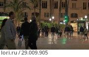 Купить «Street in evening Alicante, Spain. People crossing the road», видеоролик № 29009905, снято 19 апреля 2018 г. (c) Данил Руденко / Фотобанк Лори