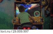 Купить «Kid having fun with racing simulator», видеоролик № 29009997, снято 11 ноября 2017 г. (c) Данил Руденко / Фотобанк Лори