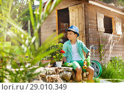 Купить «Little boy working in garden at sunny day», фото № 29010349, снято 8 мая 2018 г. (c) Сергей Новиков / Фотобанк Лори