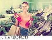 Купить «Girl searching for pair of new shoes», фото № 29010713, снято 15 сентября 2016 г. (c) Яков Филимонов / Фотобанк Лори