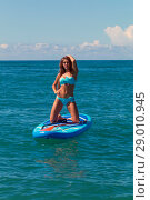 Hobby. Healthy Happy Athletic Girl In Wetsuit Paddling On Stand Up Paddle. SUP Board In Ocean. Summer Fun, Holidays Travel Vacation. Lifestyle. Recreational Water Sports. Leisure Activity. Стоковое фото, фотограф Константин Сиятский / Фотобанк Лори