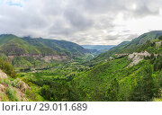 Купить «Panoramic view of Vardzia cave city-monastery. Vardzia is located in the Erusheti Mountain», фото № 29011689, снято 26 июня 2019 г. (c) Mikhail Starodubov / Фотобанк Лори