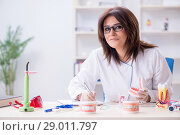 Купить «Woman dentist working on teeth implant», фото № 29011797, снято 10 апреля 2018 г. (c) Elnur / Фотобанк Лори