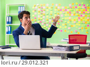 Купить «Businessman with many conflicting priorities», фото № 29012321, снято 23 мая 2018 г. (c) Elnur / Фотобанк Лори