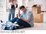 Купить «Woman evicting man from house during family conflict», фото № 29012421, снято 23 марта 2018 г. (c) Elnur / Фотобанк Лори