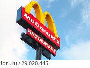 Купить «Mc Donalds restaurant logotype», фото № 29020445, снято 13 июня 2018 г. (c) EugeneSergeev / Фотобанк Лори
