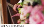 Купить «Man With Bouquet Of Flowers Meets Beloved Woman», видеоролик № 29020613, снято 31 июля 2018 г. (c) Pavel Biryukov / Фотобанк Лори