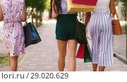 Купить «women with shopping bags walking in city», видеоролик № 29020629, снято 15 августа 2018 г. (c) Syda Productions / Фотобанк Лори