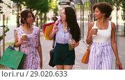 Купить «women with shopping bags and drinks in city», видеоролик № 29020633, снято 15 августа 2018 г. (c) Syda Productions / Фотобанк Лори