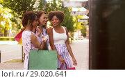 Купить «women with shopping bags looking at shop window», видеоролик № 29020641, снято 15 августа 2018 г. (c) Syda Productions / Фотобанк Лори