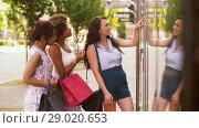 Купить «women with shopping bags looking at shop window», видеоролик № 29020653, снято 15 августа 2018 г. (c) Syda Productions / Фотобанк Лори