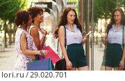 Купить «women with shopping bags looking at shop window», видеоролик № 29020701, снято 15 августа 2018 г. (c) Syda Productions / Фотобанк Лори