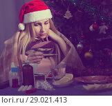 Купить «Unhealthy female is sitting in a plaid with medications in the New Year night», фото № 29021413, снято 6 января 2018 г. (c) Яков Филимонов / Фотобанк Лори