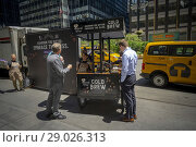 Купить «Workers man a cart on Park Avenue in New York giving out samples of Nestlé's Coffee-Mate brand Natural Bliss Cold Brew coffee at a branding event on Tuesday, June 26, 2018. (© Richard B. Levine).», фото № 29026313, снято 26 июня 2018 г. (c) age Fotostock / Фотобанк Лори