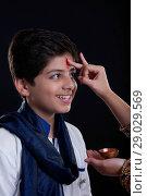 Купить «Sister applying tilak to her brother at Bhaidooj», фото № 29029569, снято 8 октября 2013 г. (c) easy Fotostock / Фотобанк Лори