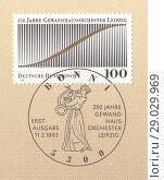 Купить «250-летие Лейпцигского симфонического оркестра Гевандхауза, символ единения звука и музыки.Штемпель девушка играет на лире,почтовая марка ФРГ 1993 года», иллюстрация № 29029969 (c) александр афанасьев / Фотобанк Лори