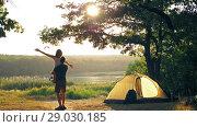 Купить «Happy couple resting on nature», видеоролик № 29030185, снято 30 августа 2018 г. (c) Илья Шаматура / Фотобанк Лори