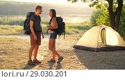 Купить «Couple with backpack on nature», видеоролик № 29030201, снято 30 августа 2018 г. (c) Илья Шаматура / Фотобанк Лори