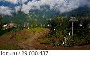 Купить «Sochi, Russia - June 12. 2018. Caucasian mountains, Rosa Khutor resort», видеоролик № 29030437, снято 15 июня 2018 г. (c) Володина Ольга / Фотобанк Лори