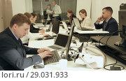 Купить «Group of successful business people during daily work in modern co-working space», видеоролик № 29031933, снято 25 апреля 2018 г. (c) Яков Филимонов / Фотобанк Лори