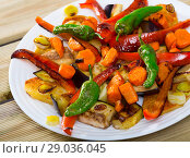 Купить «Plaque is tasty dish of Bulgarian cuisine with baked vegetable», фото № 29036045, снято 18 января 2019 г. (c) Яков Филимонов / Фотобанк Лори