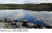 Купить «Кocks and clouds are reflected in the water Norwegian fjord in sunny day, Averoy, Norway», видеоролик № 29036593, снято 1 сентября 2018 г. (c) Некрасов Андрей / Фотобанк Лори