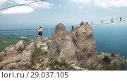 Купить «People on suspension bridge», видеоролик № 29037105, снято 9 августа 2018 г. (c) Илья Шаматура / Фотобанк Лори