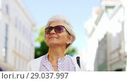 Купить «senior woman or tourist walking with city guide», видеоролик № 29037997, снято 21 августа 2018 г. (c) Syda Productions / Фотобанк Лори