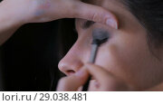 Купить «Professional make-up artist applying eyeshadow», видеоролик № 29038481, снято 11 марта 2018 г. (c) Aleksey Popov / Фотобанк Лори