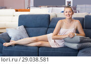 Купить «Nice female customer barefoot choosing sofa», фото № 29038581, снято 5 сентября 2017 г. (c) Яков Филимонов / Фотобанк Лори