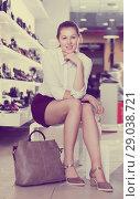 Купить «Young woman is posing with new handbag and fashion footwear», фото № 29038721, снято 13 декабря 2017 г. (c) Яков Филимонов / Фотобанк Лори