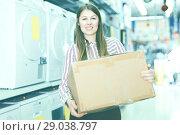 Купить «Girl holding box with purchase», фото № 29038797, снято 12 декабря 2017 г. (c) Яков Филимонов / Фотобанк Лори