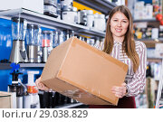 Купить «Portrait of pretty young woman with box», фото № 29038829, снято 12 декабря 2017 г. (c) Яков Филимонов / Фотобанк Лори