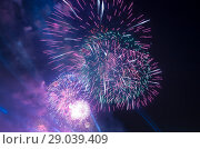 Купить «Celebratory colorful fireworks exploding in the skies», фото № 29039409, снято 9 мая 2015 г. (c) Владимир Журавлев / Фотобанк Лори