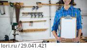 Купить «Composite image of female architect holding clipboard against grey background», фото № 29041421, снято 24 сентября 2018 г. (c) Wavebreak Media / Фотобанк Лори
