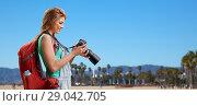 Купить «woman with backpack and camera over venice beach», фото № 29042705, снято 25 июля 2015 г. (c) Syda Productions / Фотобанк Лори