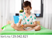 Купить «happy little boy playing with airplane toy at home», фото № 29042821, снято 19 апреля 2018 г. (c) Syda Productions / Фотобанк Лори
