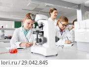 Купить «teacher and students studying chemistry at school», фото № 29042845, снято 19 мая 2018 г. (c) Syda Productions / Фотобанк Лори