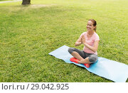 Купить «happy woman meditating in summer park», фото № 29042925, снято 15 июня 2018 г. (c) Syda Productions / Фотобанк Лори