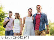 Купить «group of smiling friends with backpack hiking», фото № 29042941, снято 7 июля 2018 г. (c) Syda Productions / Фотобанк Лори