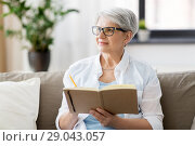 Купить «senior woman writing to notebook or diary at home», фото № 29043057, снято 24 мая 2018 г. (c) Syda Productions / Фотобанк Лори