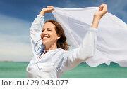 Купить «happy woman with shawl waving in wind on beach», фото № 29043077, снято 15 июня 2018 г. (c) Syda Productions / Фотобанк Лори