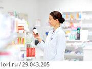 Купить «happy female apothecary with drug at pharmacy», фото № 29043205, снято 27 июня 2015 г. (c) Syda Productions / Фотобанк Лори