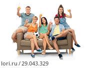 Купить «friends or soccer fans with ball and drinks», фото № 29043329, снято 30 июня 2018 г. (c) Syda Productions / Фотобанк Лори