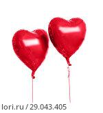 Купить «two red heart shaped helium balloons», фото № 29043405, снято 6 марта 2018 г. (c) Syda Productions / Фотобанк Лори
